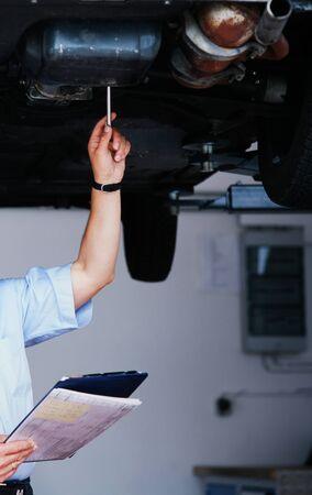 garage: man under a car
