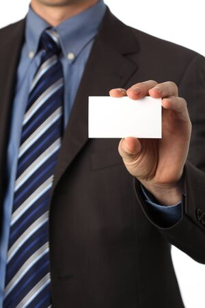 man in a suit holding a blank business card