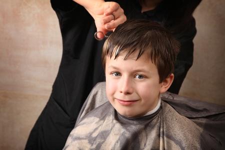 haircut: cute young boy getting a haircut