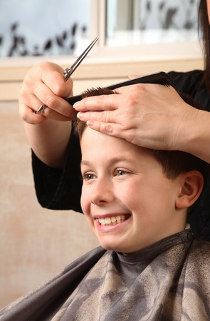 cute young boy getting a haircut photo