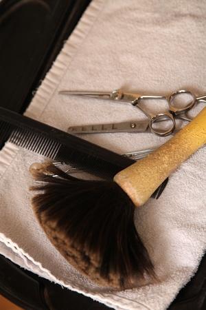 comb: stillife of scissors comb and hairbrush