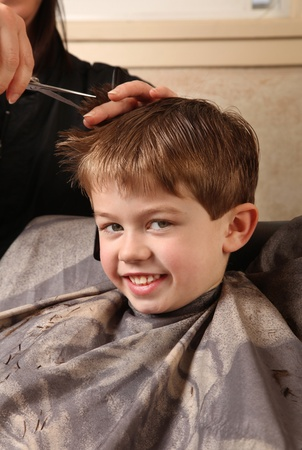 cute young boy getting a haircut Stock Photo - 9055001