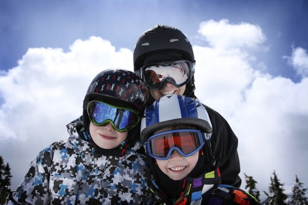 snow ski: mother with two young boys skiing