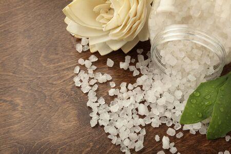 close-up of bath salt spiled on a wooden surface
