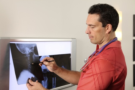 diagnosis: Chiropractor with xray Stock Photo