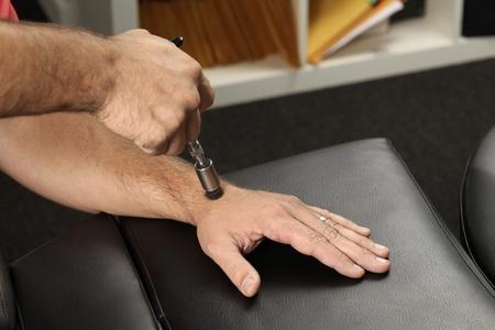Chiropractor adjusting wist bone