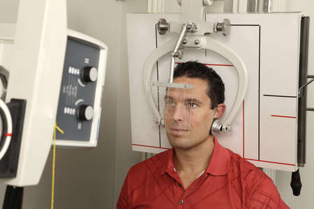 radiological: A patient getting his head x-rayed Stock Photo