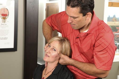 Chiropractor adjusting a female patient Stock Photo