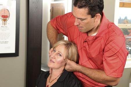 adult bones: Chiropractor adjusting a female patient Stock Photo