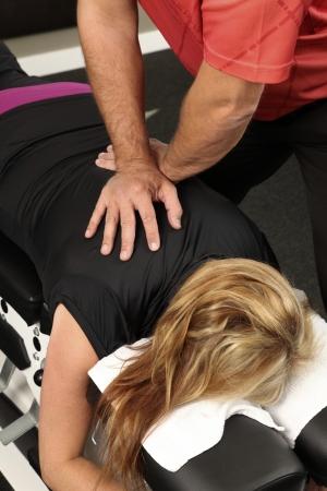 Chiropractor adjusting a female patient Standard-Bild