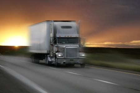 truck at sunset with motion blur Standard-Bild