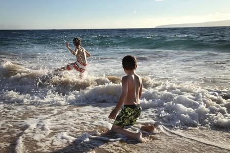 two cute boys having fun at the ocean Stock Photo - 12627505