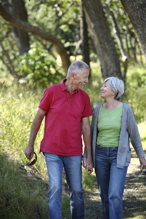 Old couple walking and holding hands Stock Photo