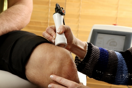 treating: Laser physiotherapy Stock Photo