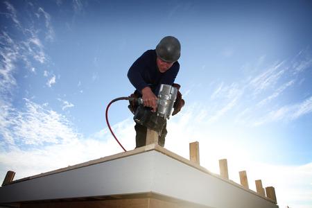 A carpenter working on a consruction site Reklamní fotografie