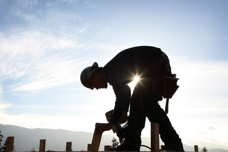 site: A carpenter working on a consruction site Stock Photo
