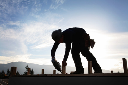 A carpenter working on a consruction site Stock Photo