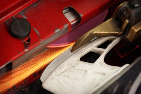 sharpening: Hockey skate getting sharpened on a machine Stock Photo