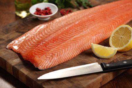 salmons: closeup of a salmon fillet on a cutting board