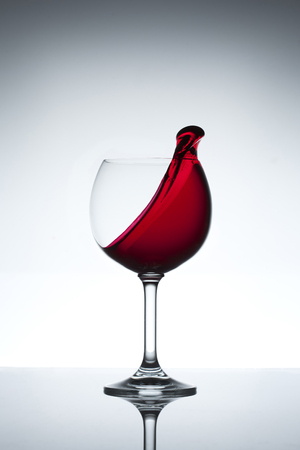 objects drink: Red wine splashing out of a glass
