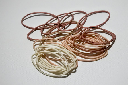 Hair bobbles in earth tones color on white background.