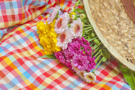 straw hat:  a straw hat and flowers  Stock Photo