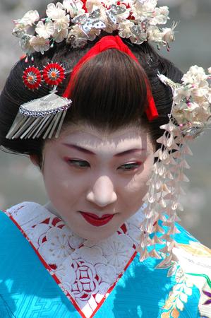 maiko: Kamishichiken Kyoto, Japan-April 03,2009 Maiko has attent to Baika-sai Festival also Baien Ume Garden Editorial