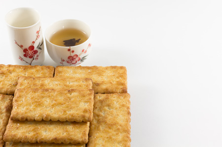 salty: Salty Crackers with Tea Stock Photo