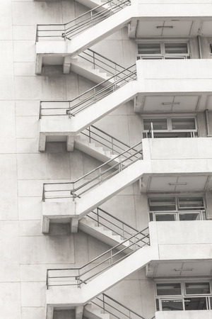 Concrete fire escape outside apartment building for emergency