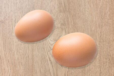wood laminate: Eggs on the wood laminate Stock Photo