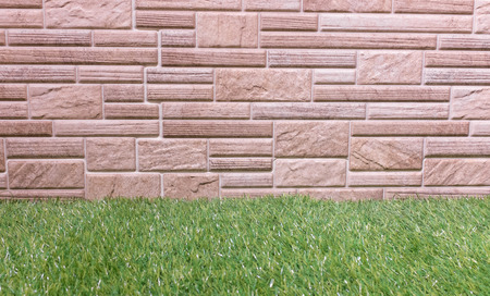 parkett: Brick wall made from laminate material with grass.