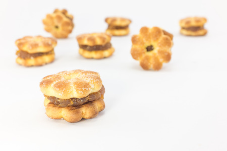 jam tarts: Biscuit with pineapple jam on white background.