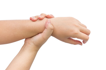 wrist pain: Female holding hand at wrist pain.