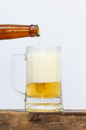 international beer: International beer day with pouring beer into glass on white background.