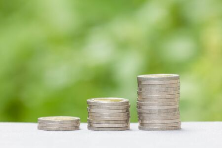 wealth: Coin stack with soft tone. Suitable use for montage in your business success background.