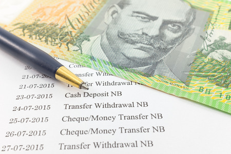 bank statement: Bank statement paper with money and pen : Can used for financial concept.