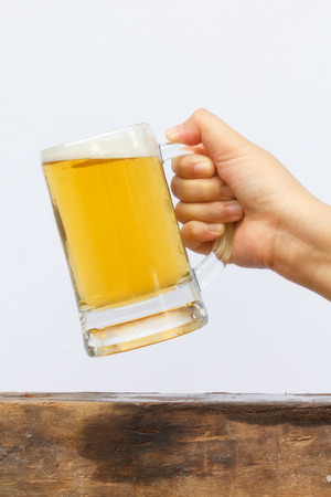 international beer: International beer day with hand holding glass beer.