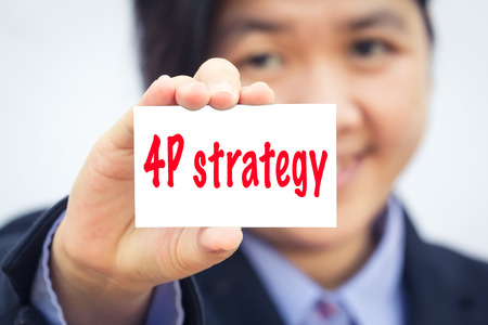 4p: Businesswoman holding card with 4P strategy message. Stock Photo