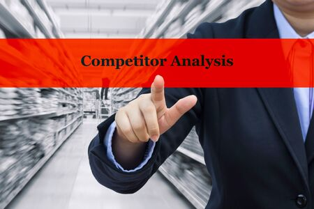 competitor: Business concept (Competitor analysis) : Businessman with blurre warehouse background.