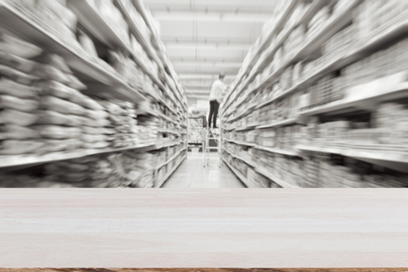 Plank wood on blurred effect warehouse or supermarket : Suitable use for montage your product.