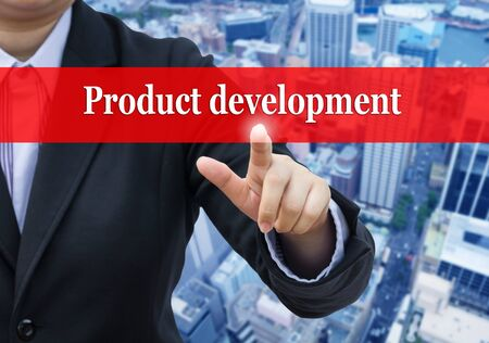 blurr: Businessman pointing to Product development on blurr business building background.