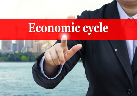 economic cycle: Businessman pointing to Economic cycle concept.