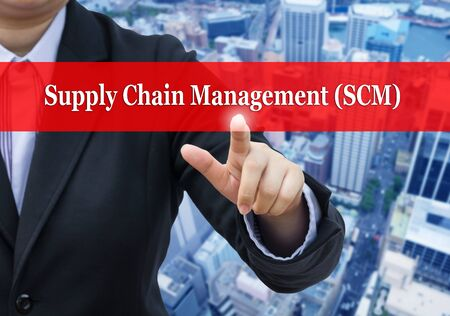scm: Businessman pointing to Supply Chain Management (SCM) concept.