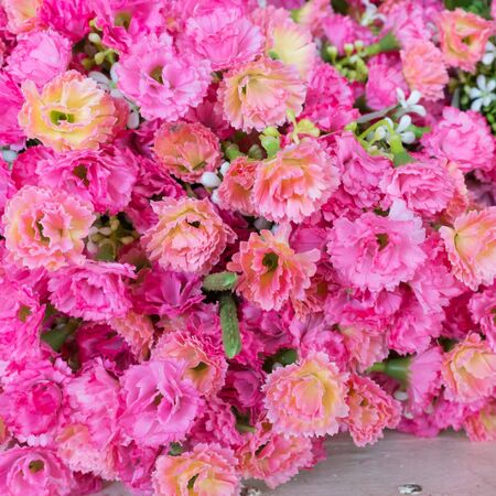 plastic made: Colourful artificial flower made from plastic and fabric. Stock Photo