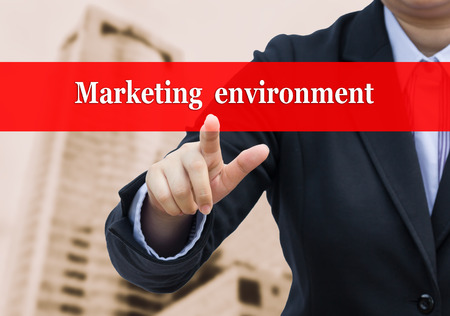 middleman: Businessman pointing to Marketing environment concept.