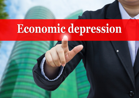 economic depression: Businessman pointing to Economic depression concept.