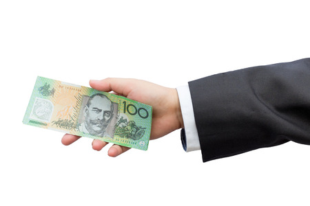 paper money: Businessman hand holding Australian dollars (AUD) on isolated background.