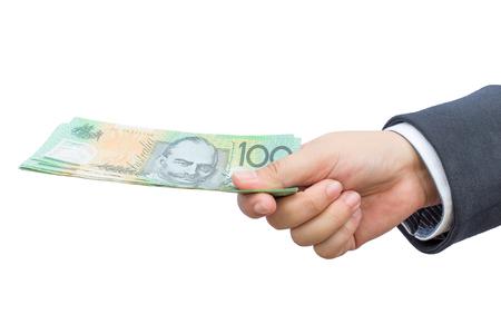 australian dollars: Businessman hand holding Australian dollars (AUD) on isolated background.