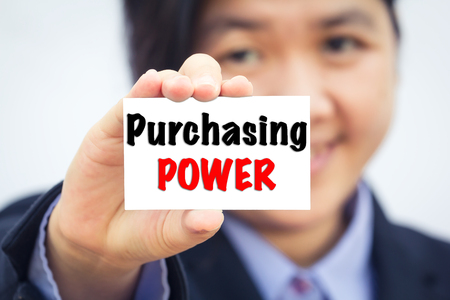 purchasing power: Businesswoman holding card with Purchasing POWER message.