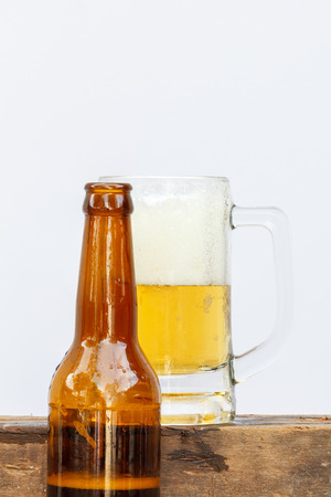 international beer: International beer day with beer glass and top beer bottle on white background.